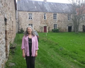 Amy Swanson Salmon in front of her 800-year old home