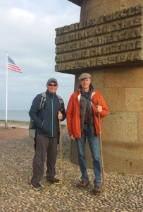 Ed and Steve on Omaha Beach, standing in front of the memorial.