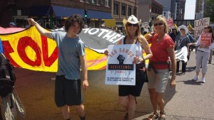 Climate Marchers Zach Solomon, Sarah Spain and Karin Sandahl at Tar Sands Resistance March in St. Paul