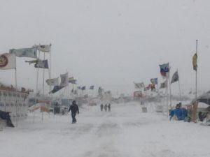 "Flags line Oceti Sakowin's ""Main Street."" Photo by Lyssa Wade."
