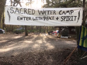 Banner welcoming visitors to the Sacred Water Camp near Live Oak, Florida and the path of the proposed Sabal Trail pipeline.