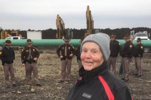 Landowner Shirley Gerjets in front of Dakota Access Pipeline built on her land taken by eminent domain.